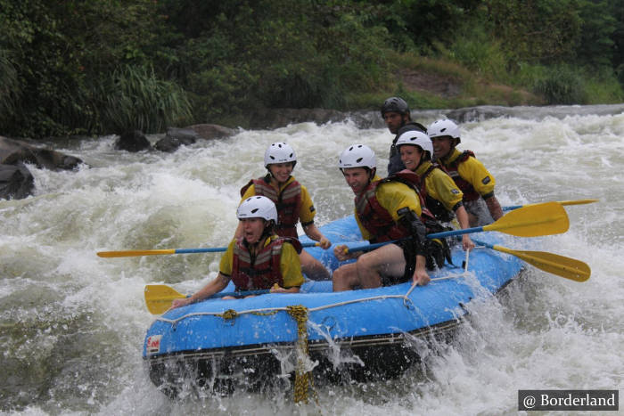 Water Rafting With A Safety Kayaker